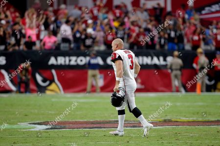 Atlanta Falcons kicker Matt Bryant (3) runs to his bench after missing a point after attempt against the Arizona Cardinals during the second half of an NFL football game, in Glendale, Ariz. The Cardinals won 34-33