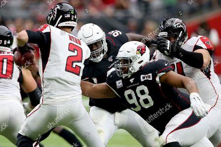 Arizona Cardinals defensive tackle Corey Peters (98) sacks Atlanta Falcons quarterback Matt Ryan (2) during the first half of an NFL football game, in Glendale, Ariz