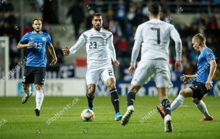 Germany's Emre Can, centre, controls the ball during the Euro 2020 group C qualifying soccer match between Estonia and Germany at the A. Le Coq Arena in Tallinn, Estonia