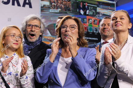 (L-R) Malgorzata Tracz, Malgorzata Kidawa-Blonska and Barbara Nowacka react during the Civic Coalition (KO) parliamentary elections night in Warsaw, Poland, 13 October 2019. An average of eleven candidates are running for each Sejm (lower house) seat in the national elections. In total, 5,114 people are running for 460 seats. Two hundred and seventy-eight people are running for the Senate (upper house), three candidatures for each seat. Five electoral committees were registered in all 41 constituencies, namely, the ruling Law and Justice (PiS) party, Poland's main opposition bloc the Civic Coalition (KO), the Polish People's Party (PSL) with the Kukiz'15 party, the Confederation Freedom and Independence and the Left (Lewica) bloc comprising liberal and left-wing parties the Democratic Left Alliance (SLD), Spring and Together.