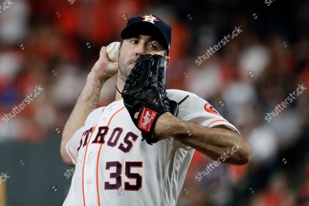 Houston Astros starting pitcher Justin Verlander throws against the New York Yankees during the first inning in Game 2 of baseball's American League Championship Series, in Houston