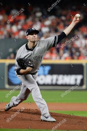 New York Yankees starting pitcher James Paxton throws against the Houston Astros during the first inning in Game 2 of baseball's American League Championship Series, in Houston