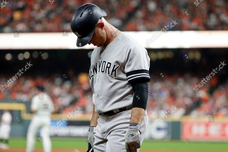 New York Yankees' Brett Gardner reacts after striking out against the Houston Astros during the second inning in Game 2 of baseball's American League Championship Series, in Houston