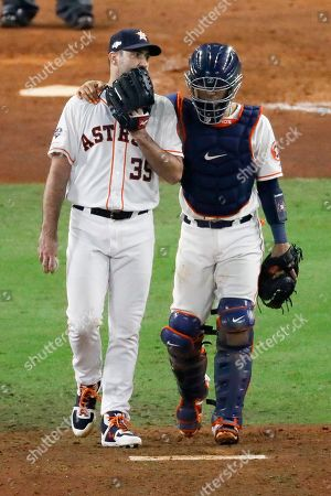 Houston Astros catcher Robinson Chirinos talks to starting pitcher Justin Verlander during the sixth inning in Game 2 of baseball's American League Championship Series, in Houston
