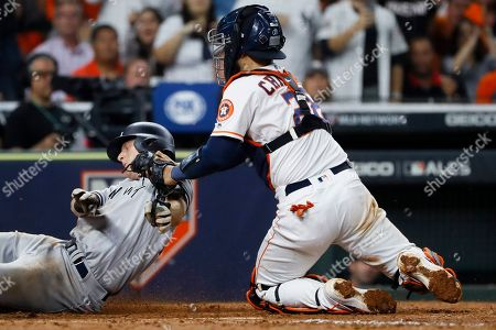 New York Yankees' DJ LeMahieu is tagged out by Houston Astros catcher Robinson Chirinos who tried to score on a single by Brett Gardner during the sixth inning in Game 2 of baseball's American League Championship Series, in Houston