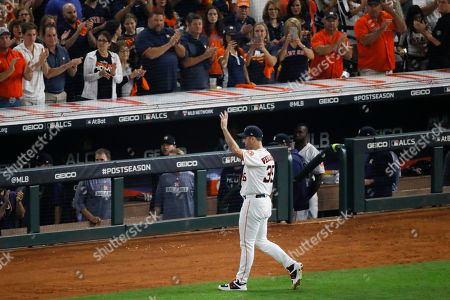 Houston Astros starting pitcher Justin Verlander waves after being taken out of the game during the seventh inning in Game 2 of baseball's American League Championship Series against the New York Yankees, in Houston