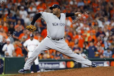 New York Yankees pitcher CC Sabathia throws against the Houston Astros during the 10th inning in Game 2 of baseball's American League Championship Series, in Houston