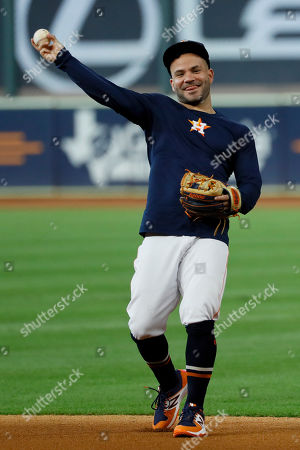 Stock Photo of Houston Astros second baseman Jose Altuve warms up during batting practice before Game 2 of baseball's American League Championship Series against the New York Yankees, in Houston