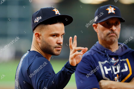 Houston Astros second baseman Jose Altuve gestures during batting practice before Game 2 of baseball's American League Championship Series against the New York Yankees, in Houston