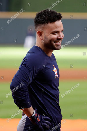 Stock Image of Houston Astros second baseman Jose Altuve smiles during batting practice before Game 2 of baseball's American League Championship Series against the New York Yankees, in Houston