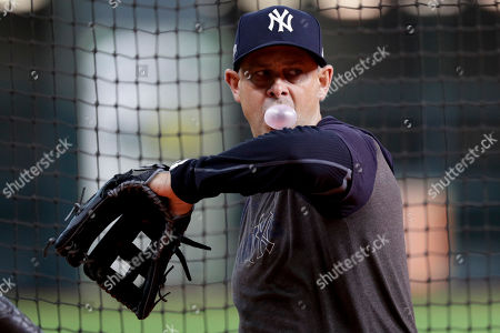 New York Yankees manager Aaron Boone watches batting practice before Game 2 of baseball's American League Championship Series against the Houston Astros, in Houston