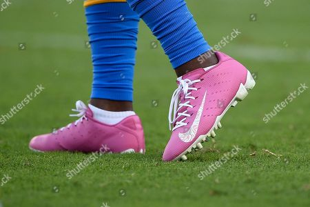 Los Angeles Chargers running back Justin Jackson's cleats are seen prior an NFL football game against the Pittsburgh Steelers, in Carson, Calif