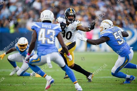 James Conner, Thomas Davis Sr. Pittsburgh Steelers running back James Conner, left, holds by Los Angeles Chargers outside linebacker Thomas Davis as he runs the ball during the first half of an NFL football game, in Carson, Calif
