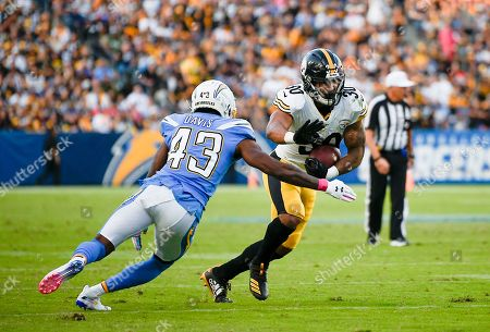 Michael Davis, James Conner. Pittsburgh Steelers running back James Conner, right, runs the ball while Los Angeles Chargers cornerback Michael Davis defends during the first half of an NFL football game in Carson, Calif
