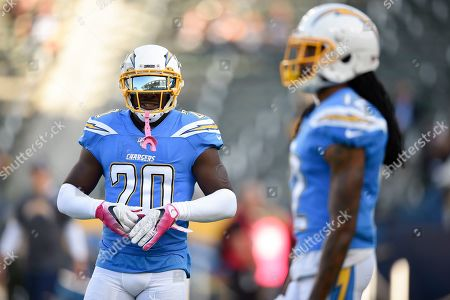 Desmond King II, Travis Benjamin. Los Angeles Chargers cornerback Desmond King II, left, warms up prior to an NFL football game with wide receiver Travis Benjamin against the Pittsburgh Steelers in Carson, Calif