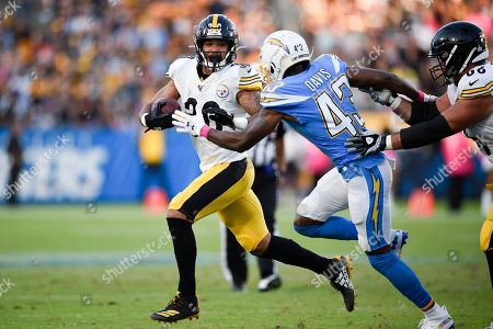James Conner, Michael Davis. Pittsburgh Steelers running back James Conner, left, runs the ball while Los Angeles Chargers cornerback Michael Davis defends during the first half of an NFL football game in Carson, Calif