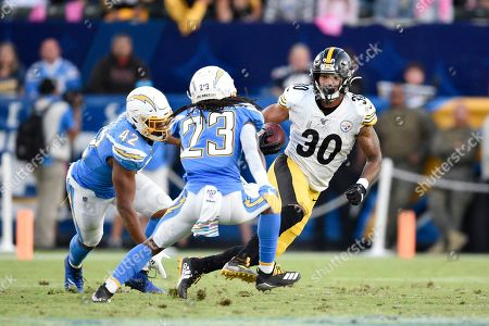 James Conner, Michael Davis, Rayshawn Jenkins. Pittsburgh Steelers running back James Conner, right, runs past Los Angeles Chargers cornerback Michael Davis, left, while safety Rayshawn Jenkins defends during the first half of an NFL football game in Carson, Calif