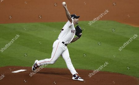 Stock Image of Houston Astros pitcher Justin Verlander throws against the New York Yankees in the top of the first inning of their MLB American League Championship Series playoff baseball game two at Minute Maid Park in Houston, Texas, USA, 13 October 2019. The winner of the best-of-seven series will go on to face either the Washington Nationals or the St. Louis Cardinals in the World Series.