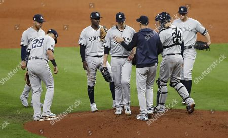 New York Yankees manager Aaron Boone (3R) removes pitcher James Paxton in the bottom of the third inning of their MLB American League Championship Series playoff baseball game two at Minute Maid Park in Houston, Texas, USA, 13 October 2019. The winner of the best-of-seven series will go on to face either the Washington Nationals or the St. Louis Cardinals in the World Series.