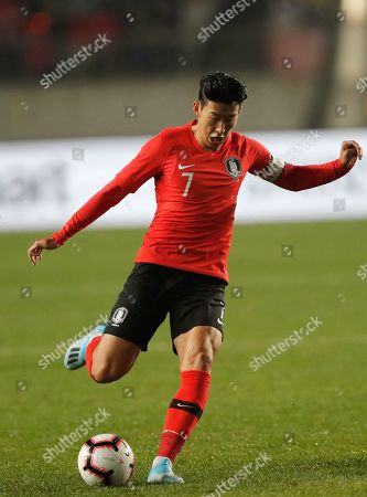South Korea's Son Heung-min kicks the ball against Sri Lanka during their Asian zone Group H qualifying soccer match for the 2022 World Cup at Hwaseong Sports Complex Main Stadium in Hwaseong, South Korea. Son Heung-min may be the biggest soccer name in South Korea and across Asia but the Tottenham forward's fame struggles to penetrate North Korea. As the two neighbors meet in a 2022 World Cup qualifier on Tuesday, the only attention the English Premier League star can expect in Pyongyang is from the home team's defenders
