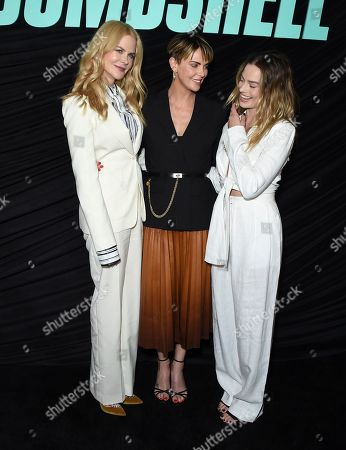 """Margot Robbie, Nicole Kidman, Charlize Theron. From left, cast members Nicole Kidman, who plays Gretchen Carlson, Charlize Theron as Megyn Kelly, and Margot Robbie, who plays Kayla Pospisil, pose at a Los Angeles special screening of """"Bombshell"""" at the Pacific Design Center on"""