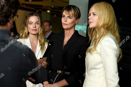 """Margot Robbie, Nicole Kidman, Charlize Theron. From left, cast members Margot Robbie, who plays Kayla Pospisil, Charlize Theron as Megyn Kelly, and Nicole Kidman, who plays Gretchen Carlson, pose at a Los Angeles special screening of """"Bombshell"""" at the Pacific Design Center on"""