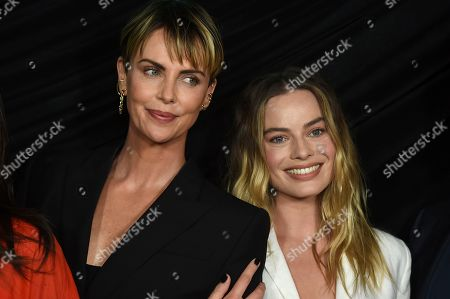 """Margot Robbie, Charlize Theron. Cast members Charlize Theron, left, who plays Megyn Kelly, and Margot Robbie, who plays Kayla Pospisil, pose at a Los Angeles special screening of """"Bombshell"""" at the Pacific Design Center on"""