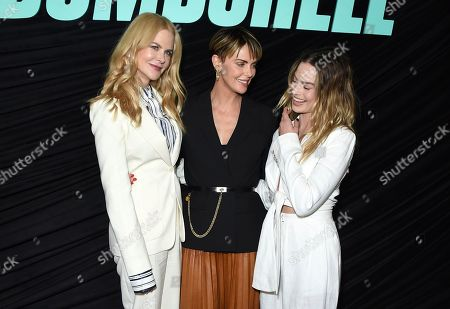 """Margot Robbie, Nicole Kidman, Charlize Theron. From left, cast members Nicole Kidman, who plays Gretchen Carlson; Charlize Theron as Megyn Kelly, and Margot Robbie, who plays Kayla Pospisil, pose at a Los Angeles special screening of """"Bombshell,"""" at the Pacific Design Center"""