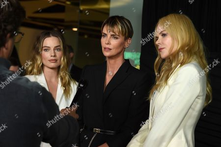 """Margot Robbie, Nicole Kidman, Charlize Theron. From left, cast members Margot Robbie, who plays Kayla Pospisil; Charlize Theron as Megyn Kelly, and Nicole Kidman, who plays Gretchen Carlson, pose at a Los Angeles special screening of """"Bombshell,"""" at the Pacific Design Center"""