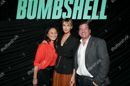 Stock Photo of Beth Kono, Producer, Charlize Theron and A.J. Dix, Producer, attend Lionsgate's BOMBSHELL special screening at the Pacific Design Center in West Hollywood, CA