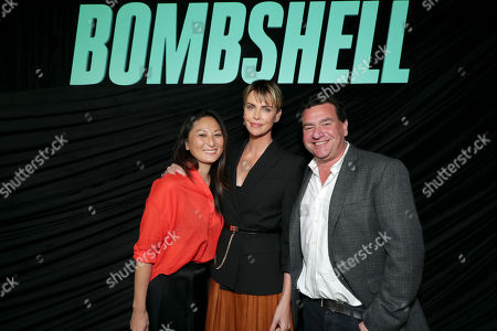Stock Picture of Beth Kono, Producer, Charlize Theron and A.J. Dix, Producer, attend Lionsgate's BOMBSHELL special screening at the Pacific Design Center in West Hollywood, CA