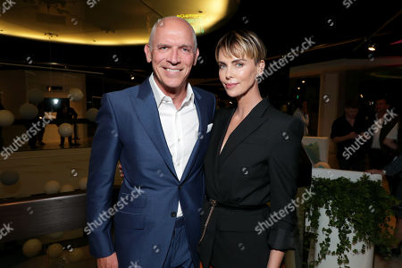 Joe Drake, Chairman, Lionsgate Motion Picture Group, and Charlize Theron attend Lionsgate's BOMBSHELL special screening at the Pacific Design Center in West Hollywood, CA