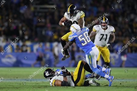 Stock Picture of Pittsburgh Steelers running back James Conner (top) tries to leap over bodies as Los Angeles Chargers outside linebacker Thomas Davis (C) applies the hit during the NFL American Football game between the Pittsburg Steelers and the Los Angeles Chargers at the Dignity Health Sports Park in Carson, California, USA, 13 October 2019.