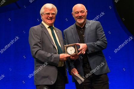 Stock Image of Ian Hudghton, President of the Scottish National Party (SNP), presents the President's Prize to John Robertson