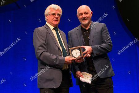 Stock Photo of Ian Hudghton, President of the Scottish National Party (SNP), presents the President's Prize to John Robertson