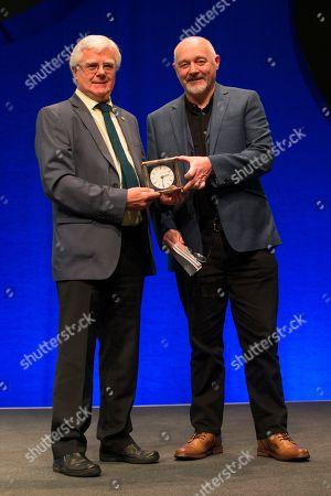 Ian Hudghton, President of the Scottish National Party (SNP), presents the President's Prize to John Robertson