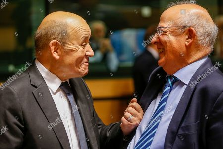 French Foreign Affairs Minister, Jean-Yves Le Drian (L) talks with Portuguese Minister for Foreign Affairs Augusto Santos Silva (R) at the start of the Foreign Affairs Council in Luxembourg, 14 October 2019. The Foreign Affairs Council will start with a discussion on current affairs and will discuss Turkey's continued drilling activities in the Eastern Mediterranean.