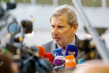 European Commissioner for Neighborhood Policy and Enlargement Negotiations Johannes Hahn speaks to media as he arrives for the Foreign Affairs Council in Luxembourg, 14 October 2019. The Foreign Affairs Council will start with a discussion on current affairs and will discuss Turkey's continued drilling activities in the Eastern Mediterranean.
