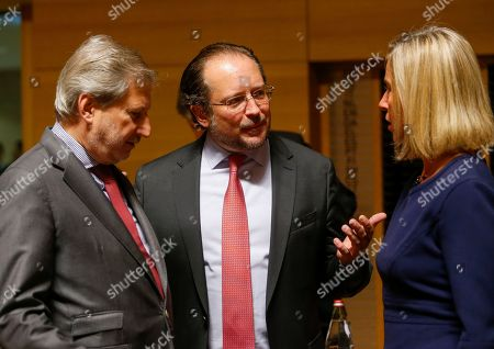 Stock Photo of (L-R) European Commissioner for Neighborhood Policy and Enlargement Negotiations Johannes Hahn, Austrian Minister of Foreign Affairs Alexander Schallenberg and The High Representative of the European Union for Foreign Affairs and Security Policy Federica Mogherini  at the start of the Foreign Affairs Council in Luxembourg, 14 October 2019. The Foreign Affairs Council will start with a discussion on current affairs and will discuss Turkey's continued drilling activities in the Eastern Mediterranean.