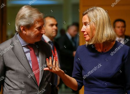 European Commissioner for Neighborhood Policy and Enlargement Negotiations Johannes Hahn (L) talks with The High Representative of the European Union for Foreign Affairs and Security Policy Federica Mogherini (R) at the start of the Foreign Affairs Council in Luxembourg, 14 October 2019. The Foreign Affairs Council will start with a discussion on current affairs and will discuss Turkey's continued drilling activities in the Eastern Mediterranean.