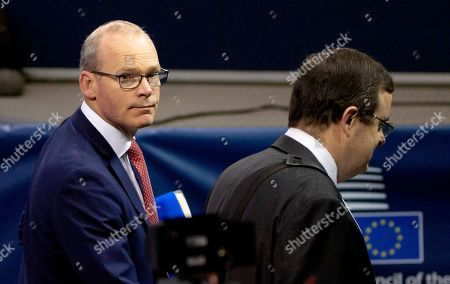 Irish Foreign Minister Simon Coveney, left, arrives for a meeting of EU foreign ministers at the European Convention Center in Luxembourg, . Ireland says that a Brexit deal may be possible in the coming days, after technical teams from Britain and the European Union worked through the weekend