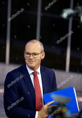 Irish Foreign Minister Simon Coveney speaks with the media as he arrives for a meeting of EU foreign ministers at the European Convention Center in Luxembourg, . Ireland says that a Brexit deal may be possible in the coming days, after technical teams from Britain and the European Union worked through the weekend