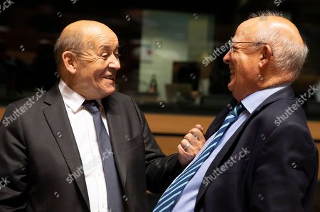 Stock Photo of French Foreign Minister Jean-Yves Le Drian, left, speaks with Portuguese Foreign Minister Augusto Santos Silva during a meeting of EU foreign ministers at the European Convention Center in Luxembourg, . Some European Union nations are looking to extend moves against Turkey by getting more nations to ban arms exports to Ankara to protest the offensive in neighboring Syria