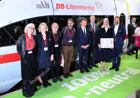 Stock Picture of (L-R) Norwegian authors Anna Fiske, Maria Paar, Jostein Gaarder and Svein Nyhus, the CEO of Deutsche Bahn, Richard Lutz, the Norwegian ambassador in Germany, Peter Ollberg, and Norwegian Crown Princess Mette-Marit and Crown Prince Haakon pose for pictures before boarding the Literature Train of the German Railways on their way to the Frankfurt Book Fair, in Berlin, Germany, 14 October 2019. The Norwegian royals are traveling from Berlin to Frankfurt via Cologne where they will meet with a group of Norwegian authors heading to the international book fair in Frankfurt am Main. The Frankfurter Buchmesse 2019 runs from 16 to 20 October. Norway is this year's guest of honor.