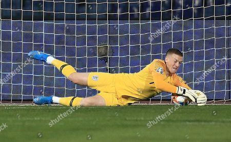 Jordan Pickford of England makes a save