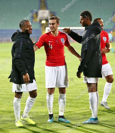 Raheem Sterling,Harry Winks  and Marcus Rashford of England after the match