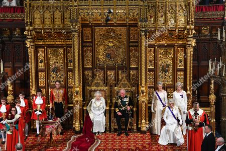 Queen Elizabeth II, Prince Charles and Camilla Duchess of Cornwall during the State Opening of Parliament in the House of Lords at the Palace of Westminster in London.