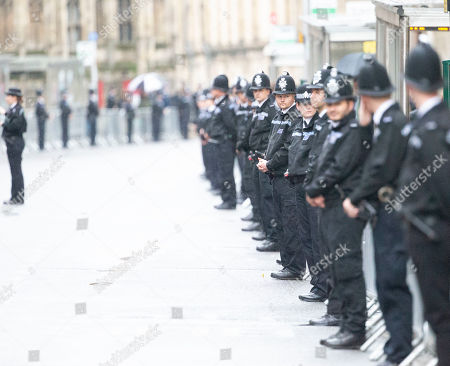 Police Officers standing on the route of the funeral cortege for PC Andrew Harper in Oxford High Street