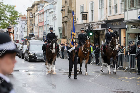 The cortege for PC Andrew Harper makes its way up the High Street in Oxford.