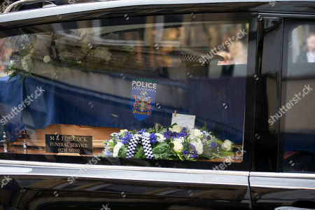 The coffin of PC Andrew Harper makes its way up the High Street